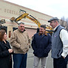 Lynn, Old GE building on Federal Street. Tear down begins to make way for a Market Basket.  Mayor Judith Kennedy and buiding owner Charlie Patsios talk with Jamie Marsh and Jim Cowdell.