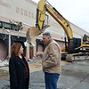Lynn, Old GE building on Federal Street. Tear down begins to make way for a Market Basket.  Mayor Judith Kennedy and buiding owner Charlie Patsios watch as the demolition begins on Monday.