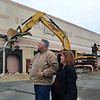 Lynn, Old GE building on Federal Street. Tear down begins to make way for a Market Basket.  Mayor Judith Kennedy and building owner Charlie Patsios watch as the demolition begins on Monday.