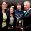 State Senator Thomas McGee holds his Irishman of the Year award with his wife, Maria, daughter Katherine, 14, and son Thomas, 14, at the Friendly Knights of St. Patrick dinner Old Tyme Restaurant on Thursday, March 15. Item Photo / Angela Owens.