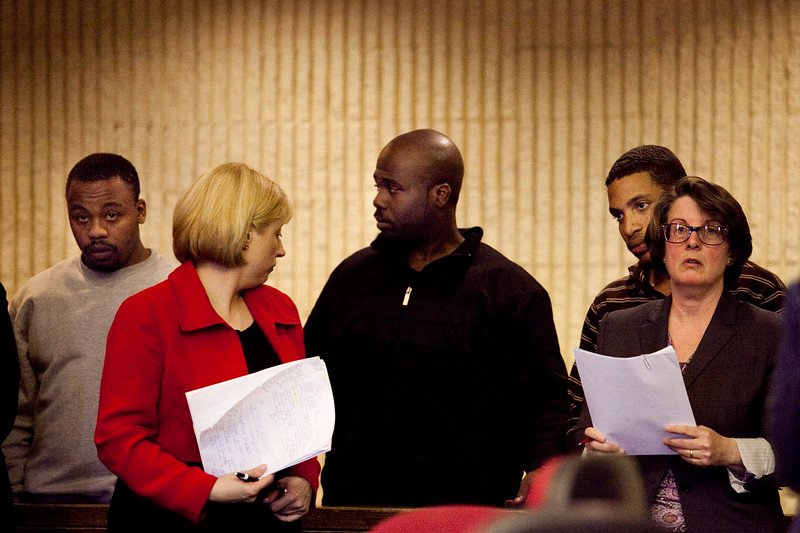 Nequiest Williams, Valmir Lindor, and Brandon Ramsay stand in the dock, behind their attorneys, during their arraignment at Lynn District Court on Thursday, March 15. Item Photo / Angela Owens.