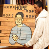 """Kadeem Dalley holds a xylophone that says """"Hope,"""" which was a project at Raw Arts, during the youth forum at Temple Ahabat Shalom in Lynn on Thrusday, March 15. Item Photo / Angela Owens."""