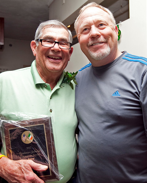 John Pace holds his community service award, as he poses for a photo with Dave Raymond, at the Friendly Knights of St. Patrick dinner at Old Tyme Restaurant on Thursday, March 15. Item Photo / Angela Owens.
