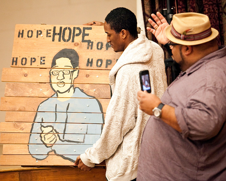 """Jason Cruz, clinical supervisor and art therapist at Raw Arts, motions towards Kadeem Dalley during the youth forum at Temple Ahabat Shalom in Lynn on Thrusday, March 15. Dalley is holding a xylophone that says """"Hope,"""" which was a project at Raw Arts. Item Photo / Angela Owens."""