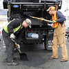 Erick Kneeland, left, and Matt Trahant, right, fixing a pothole on Myrtle Street in Lynn