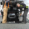 Matt Trahant, left, and Erick Kneeland, right, fixing a pothole on Myrtle Street in Lynn.