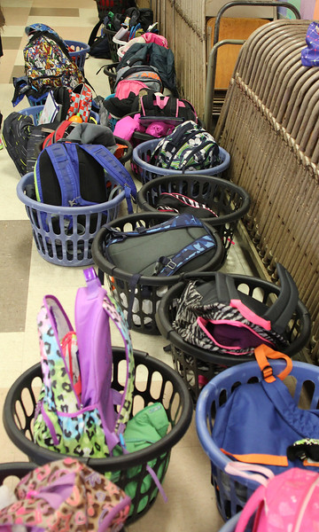 Kids still carry backpacks as evidenced by these that are stored at the Shoemaker Elementary School in Lynn as their owners participate in the Absolutely Incredible Kid program. Photo by Owen O'Rourke