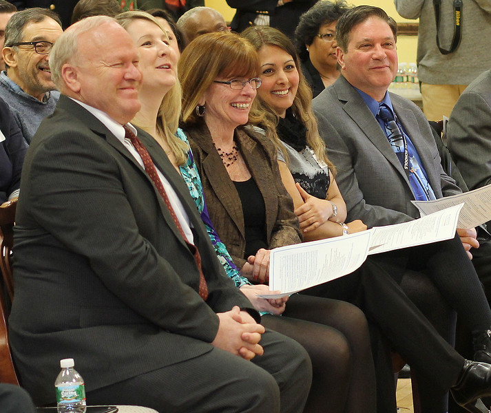 Richard Held, Director of Science City of Lynn, Rachel Attridge, lead Science teacher at Marshall Middle School, Cinci Quaratielloo, Science teacher at Breed Middle School, Banafsheh Salamat, Science Department Chair, and Robert Buontempo Jr. Principal at Lynn Vocational Technical Institute, listening to speakers at the Massachusetts Life Science Center in Roxbury today where Lynn schools received grant money. Photo by Owen O'Rourke