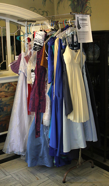 Used prom dresses on the rack at Marian Court College in Swampscott, part of the Northshore Fairy Godmother project. Photo by Owen O'Rourke