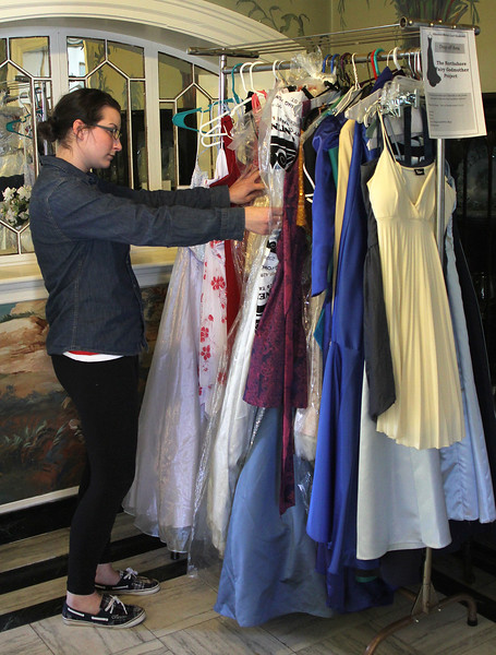 Rebecca Sarro, a student at Marian Court College in Swampscott, looks at used prom dresses at Marian Court College that are part of the Northshore Fairy Godmother project. Photo by Owen O'Rourke