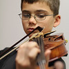 Eleven year old Doug Dubin will give a violin performance at the Village Church in Nahant on Thursday. Photo by Owen O'Rourke