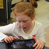 Lily Lyman works on one of the many tablets available during Absolutely Incredible Kids Day at the Shoemaker School in Lynn. Photo by Owen O'Rourke