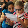 Sailet Galvis, left, and Jessica Howell, right, read a letter about them written by the councilors at camp Fire North Shore Absolutely Incredible Kid Day at the Shoremaker Elementary School in Lynn. Photo by Owen O'Rourke