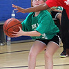 West Lynn's Mary Collins (Sewell-Anderson School) takes the ball to the basket during the girl's elementary all-star basketball game at the Sisson School on Saturday. Photo by Owen O'Rourke