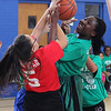 Jenny Matul (Ford School) left, and Favour Agbonsalo (Sewell-Anderson School) right, struggle for the rebound during the girl's elementary schooll all star basketball game played at the Sisson Elementary School on Saturday. Photo by Owen O'Rourke
