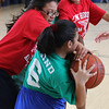 Jessica Reyes (Drewicz School) right, and Nayelis Diaz (Ingalls School) right, struggle for the ball during the girl's elementary basketball ll star game played at the Sisson School on Saturday. Photo by Owen O'Rourke