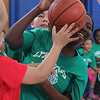 Favor Agbonsalo, (Sewell-AndersonSchool) struggles for the rebound during the elementary school basktball all star game on Saturday played a the Sisson School in Lynn. Photo by Owen O'Rourke