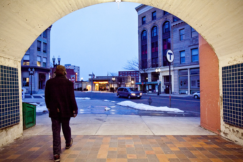 A man walks through the tunnel under the Central Square commuter rail station on Monday, March 4. Item Photo / Angela Owens.