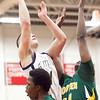 Snowden's Derron Stone (21) attempts to block a shot by St. Mary's Tommy Deveau (1) during their game at Chelsea High School on Monday, March 4. Item Photo / Angela Owens.