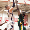Snowden's Derron Stone (21) attempts to block a shot by St. Mary's Matt Manning (20) during their game at Chelsea High School on Monday, March 4. Item Photo / Angela Owens.