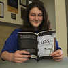 Maggie Dunn, a seventh grade student at Our Lady of the Assumtion School in Lynnfield, with her new book. Photo by Owen O'Rourke