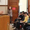 John Festa, left, talks to students from Harvard University in the counci chambers in Revere today. Photo by Owen O'Rourke