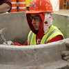 Matthew Cennami, a student at Lynn Vocational Technical Institute, in a manhole doing an invert during classes held by the New England Laborer's Union this week. Owen O'Rourke