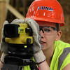 Sam Rand, a student at Lynn Vocational Technical Institute, uses a autolevel, a tool in surveying, duirng the week long classes put on by the New England Laborer's Union. Photo by Owen O'Rourke