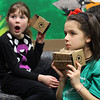 Chloe Ciesliewicz, left, and Ava Brecken-Cruz, right, both in second grade at the Huckleberry Hill Elementary School in Lynnfield, react differently to what they saw during Google Expedition today. Photo by Owen O'Rourke