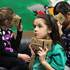 Second grader Ava Brecken-Cruz, middle, ponders what she saw in the Google Expedition as her two classmates, Chloe Cieslewicz, left, and April Sun, right, keep looking during the Google Expedition's visit to the Huckleberry Hill Elementary School in Lynnfield today. Photo by Owen O'Rourke