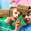 Nicholas Kelter, left, and Kamden Mauser, right, talk about what they are looking at during the Google Expedition experience at the Huckleberry Hill Elementary School in Lynnfield today. Photo by Owen O'Rourke