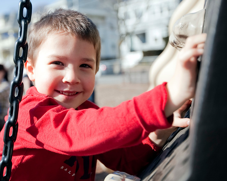 Brennan Connor, 4, climbs on the playground at a Swampscott park on Thursday, March 8. Item Photo / Angela Owens.