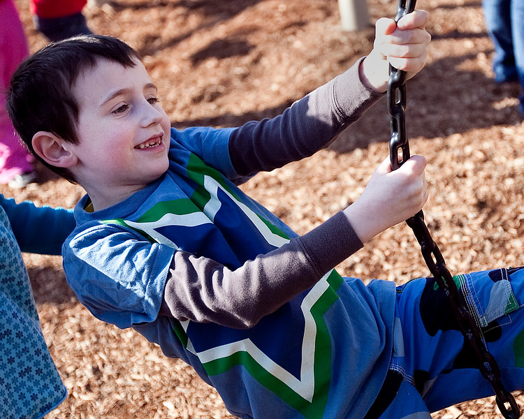 Riley Richard, 7, climbs on the playground at a Swampscott park on Thursday, March 8. Item Photo / Angela Owens.
