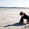 Alex Mahoney, 4, digs for treasure at Lynn / Nahant beach, on Thursday, March 8. Mahoney and his grandparents came to the beach to enjoy the particularly warm weather. Item Photo / Angela Owens.