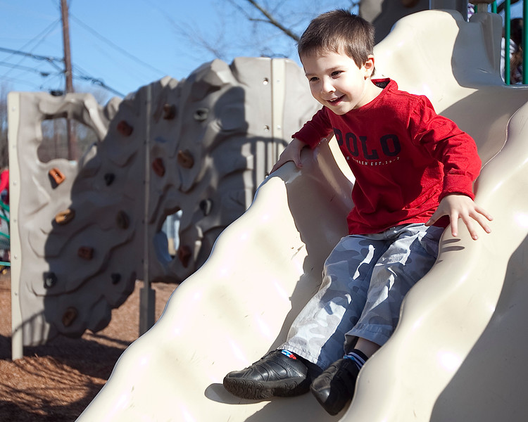 Brennan Connor, 4, plays on the slide at a Swampscott park on Thursday, March 8. Item Photo / Angela Owens.