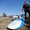 John Falat, from Nahant, packs up his gear after an afternoon of windsurfing at Lynn / Nahant beach on Thursday, March 8.