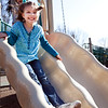 Kalie Connor, 7, plays on the slide at a Swampscott park on Thursday, March 8. Item Photo / Angela Owens.