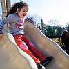 Erika Richard, 5, plays on the slide at a Swampscott park on Thursday, March 8. Item Photo / Angela Owens.