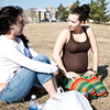Phylisha Hammett, 21, and Danielle Hadley, 20, enjoy the warm weather along Lynn Shore Drive on Thursday, March 8. Item Photo / Angela Owens.