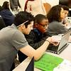 Saugus. Pioneer Charter School Saturday Classes.<br /> Andrew Rice, Math Teacher, helps Kamar Cesar-Elivert, Melrose, before classes.
