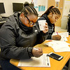 Saugus. Pioneer Charter School Saturday Classes.<br /> 10th grade ELA Test Prep.  lft Valerie Robert, Lynn and rt. Lourdes Desameau, Everett, work on answers during  a practise test.