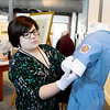 Lynn, Lynn Musuem.  Nicole Breault, Lynn, Educational Programs Coordinator, with a 1950s style uniform worn by student nurses at Lynn Hospital.