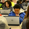 Saugus. Pioneer Charter School Saturday Classes.<br /> Nidley Jean-Baptiste, Melrose, 7th grade, reviews his work in the cafeteria before classes start.