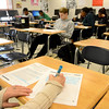 Saugus. Pioneer Charter School Saturday Classes.<br /> 10th grade ELA Test Prep.  Teacher Deborah Maxey writes out the answer as students take a practice test.