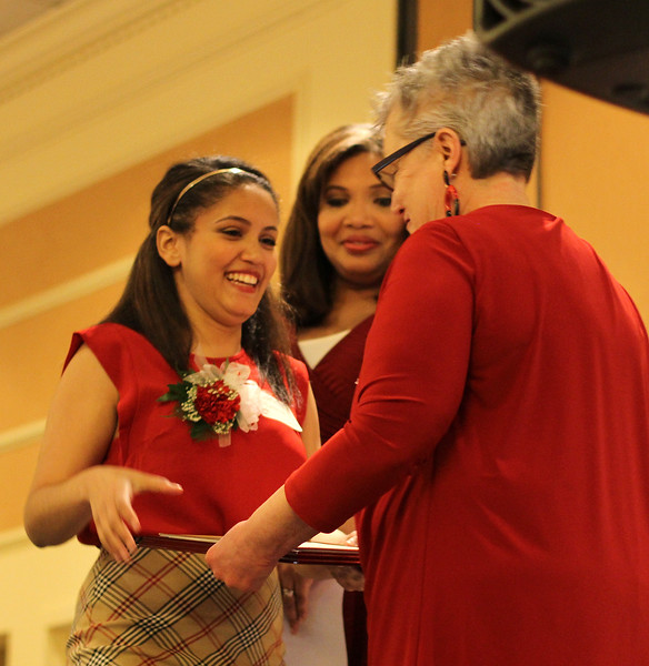 Girl Hero Zurich Deleon accepting her Girl Hero award from Deb Ansourlian, Executive Director at Girl's Inc. at the 28th annual celebration luncheon. Behind her is Latoyia Edwards from NECN.
