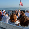 Lynn Ferry on its way to Boston.  Passengers enjoying the sun and view from the seats on the deck.