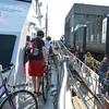 Lynn ferry arrives at the Aquarium in Boston.  Passengers disembark.