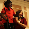 Sandra Adetola, a member of the Girl's Inc. Chorus and Latoyia Edwards have a moment at the 28th annual Girl's Inc. celebration luncheon. Photo by Owen O'Rourke