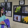 Madison Diehl is one of the 15 Swampscott Middle School students in the photo club that is exhibiting work in the school. Photo by Owen O'Rourke