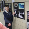 Lloyd Pearce is one of the 15 Swampscott Middle School students in the photo club. Here he explains his work to viewers. Photo by Owen O'Rourke